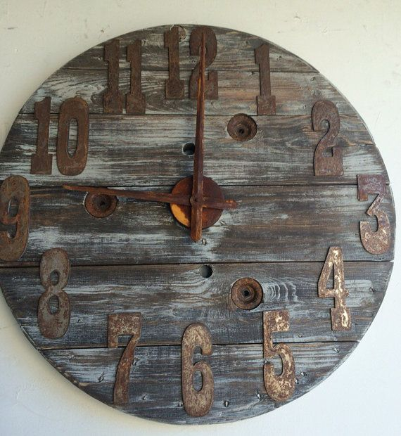 30 inch diameter- Fully functional repurposed/upcycled wooden cable spool clock. Great rustic home décor piece. This clock has been beautiful distressed with rusty metal numbers/ numerals. Customized to your color choice and number finish. Please specify if you would like numbers