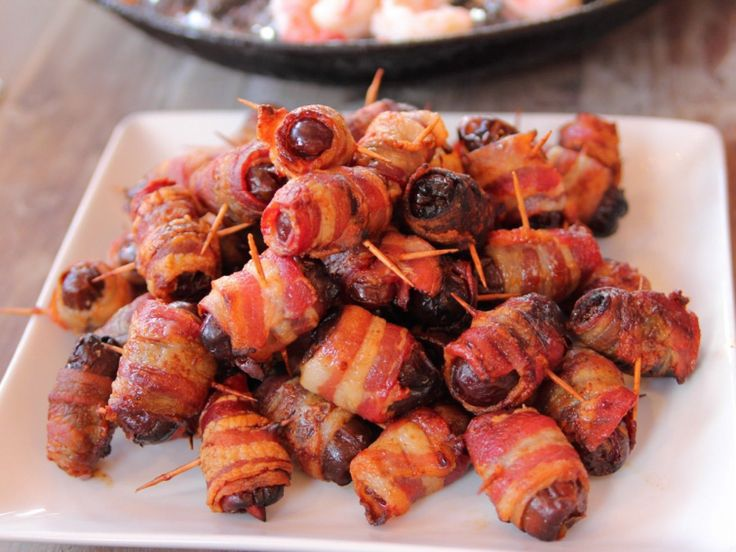 Bacon-Wrapped Dates : Featuring chewy sweet dates, crunchy salted roasted almonds and a blanket of crispy bacon, these fast-fix bites are easy to prep and eat.