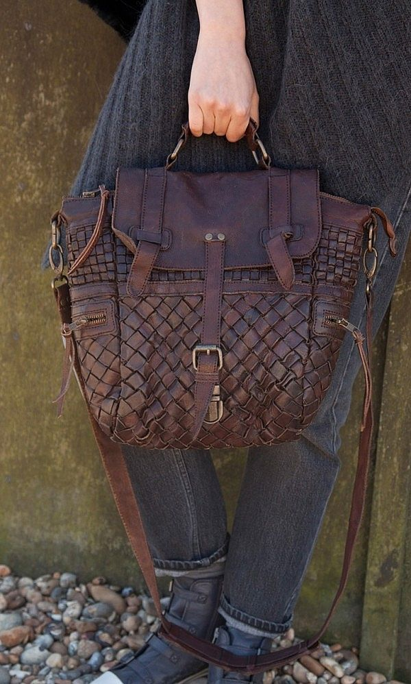 Woven leather satchel  Code BBG026  Intricately woven leather satchel with flap front and buckle closure. Zip side pockets. Top handle. Detachable strap. Lined. W35cm H30cm D12cm Strap L64cm.  £179.00