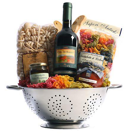 Great Gift Basket idea: Italian wine, colander, unique pasta, tomato sauce, pesto, and biscotti. Maybe a wooden spoon or two?