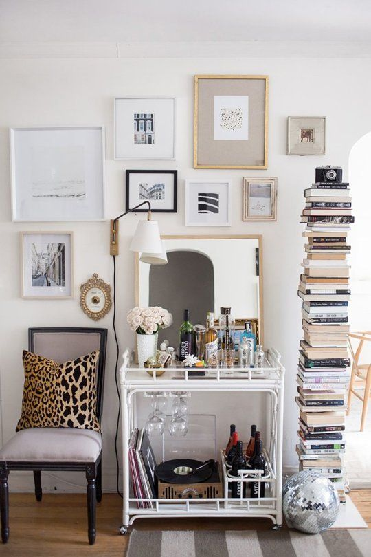 Love the Sapien bookcase next to the Louis XVI neoclassical chair, bar cart, hanging lamp and gallery wall PLUS disco ball....PERFECTION