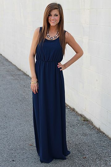 """The simple elegance of this dress is what makes this maxi such a knockout dress! The loose strap detail in the back is not to be overlooked! Fits true to size. Miranda is wearing the small. Shoulder to hem: S - 56.5"""" M - 57"""" L - 57.5"""""""
