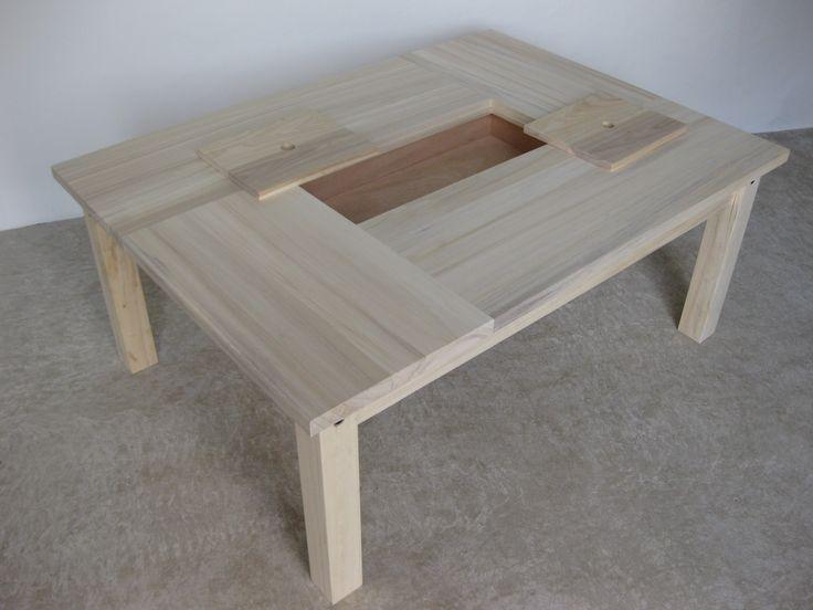 Table basse en bois brut avec rangement meubles design for Meuble rangement bois brut