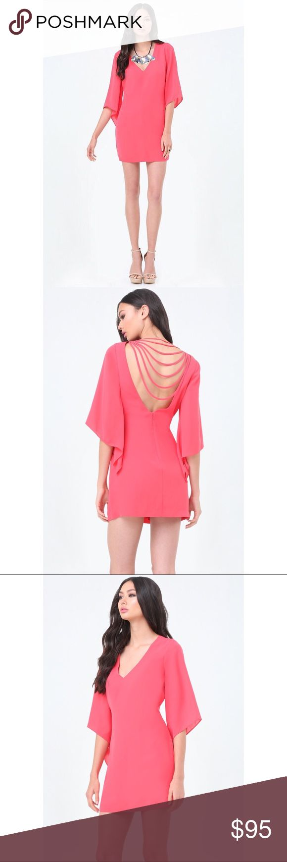 """FLARE SLEEVE SHIFT DRESS Beautiful flare sleeve, hot pink dress. Perfect for a night out! Bought for an event and never ended up wearing it. I'm 5'4"""" for height reference bebe Dresses"""