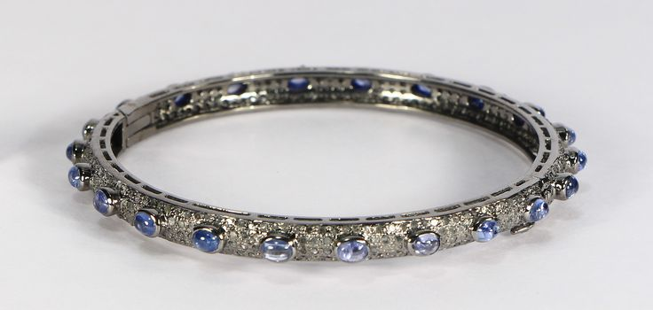 Bangle in 925 Sterling Silver with Pave Diamonds and Blue Sapphire. This Bangle opens and has a safety lock.  (scheduled via http://www.tailwindapp.com?utm_source=pinterest&utm_medium=twpin)