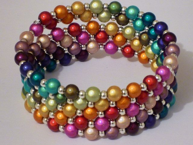 Love those miracle beads!  These are strung on memory wire with little silver spacers.  this would be a nice peyote pattern
