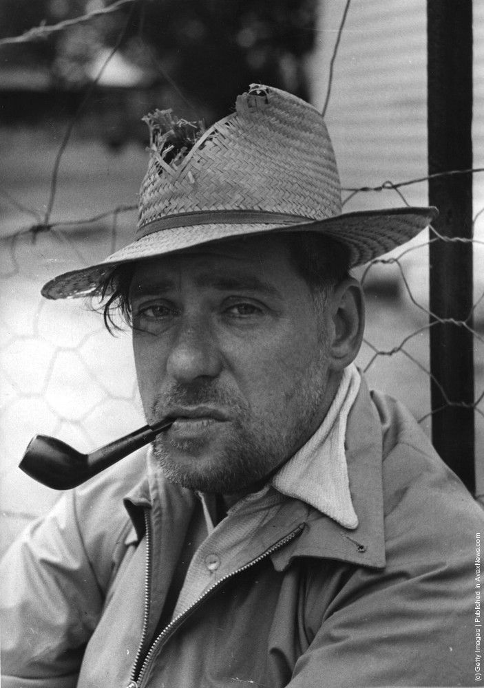 British photographer, Bert Hardy (1913–1994), smokes a pipe while on an assignment in southern Africa. 29th April 1950