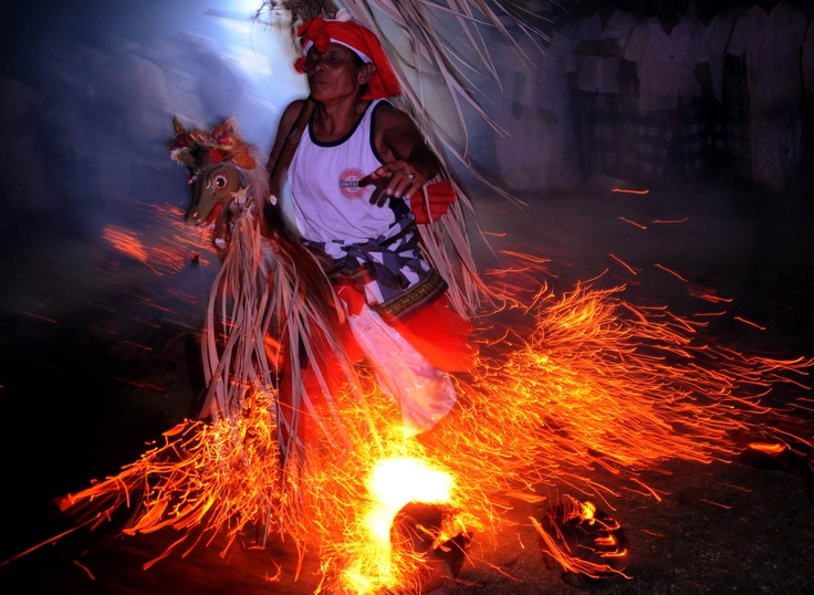 A Balinese man walks across fire during the Sanghyang jaran ritual dance performed at a temple in Kuta on Indonesia's resort island of Bali on June 22, 2012. Sanghyang jaran is a dance performed by boys riding coconut palm hobbyhorses in and around a fire. (AFP Photo/Sonny Tumbelaka)