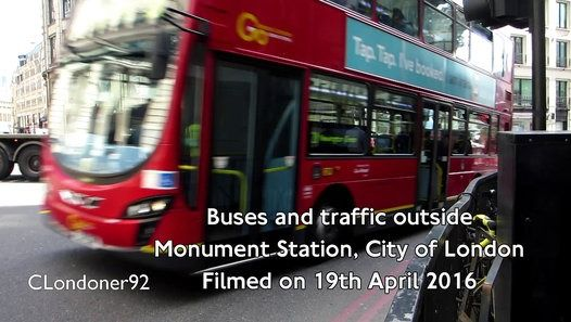 Buses and traffic outside Monument Station, City of London Filmed on 19th April 2016