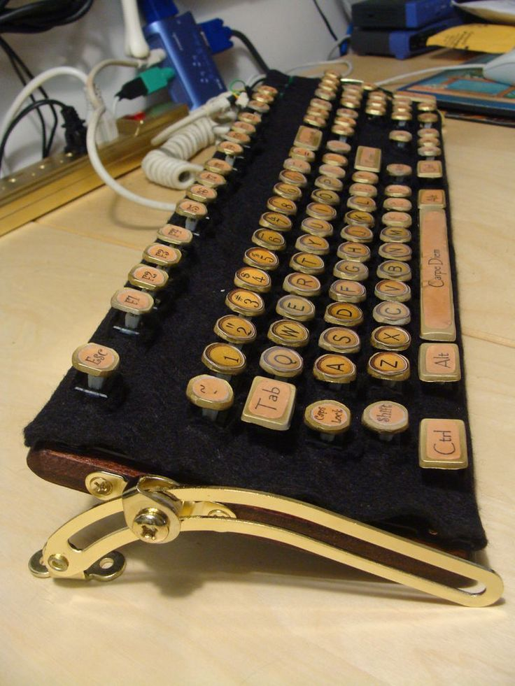 Cheap and Easy Steampunk Keyboard. Based on the incredibly beautiful (and incredibly expensive) keyboard from Datamancer. With a bit of Photoshop know how and access to a nice color printer, you could design your keys any way you like instead of using stickers. Just remember to seal all stickers and paper with resin or many many coats of polyurethane to make your keyboard hold up to use.