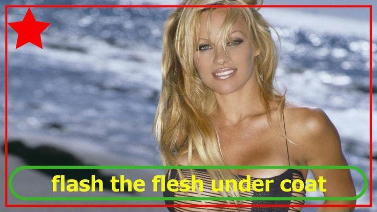 Pamela Anderson strips naked to flash the flesh under coat