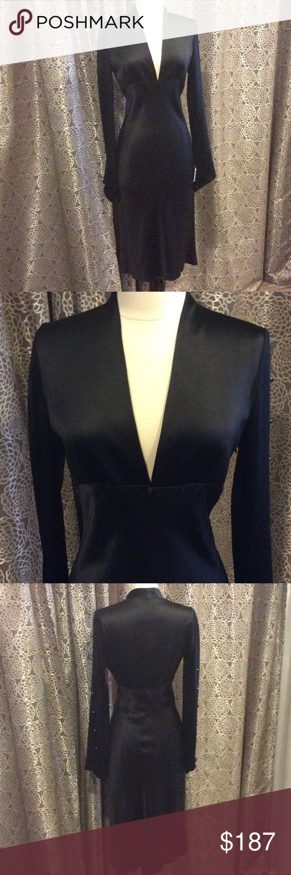 Monique Lhuillier silk dress Monique Lhuillier dress with deep v cut. Long sleeves with buttons down the arm. Zips up the side Monique Lhuillier Dresses
