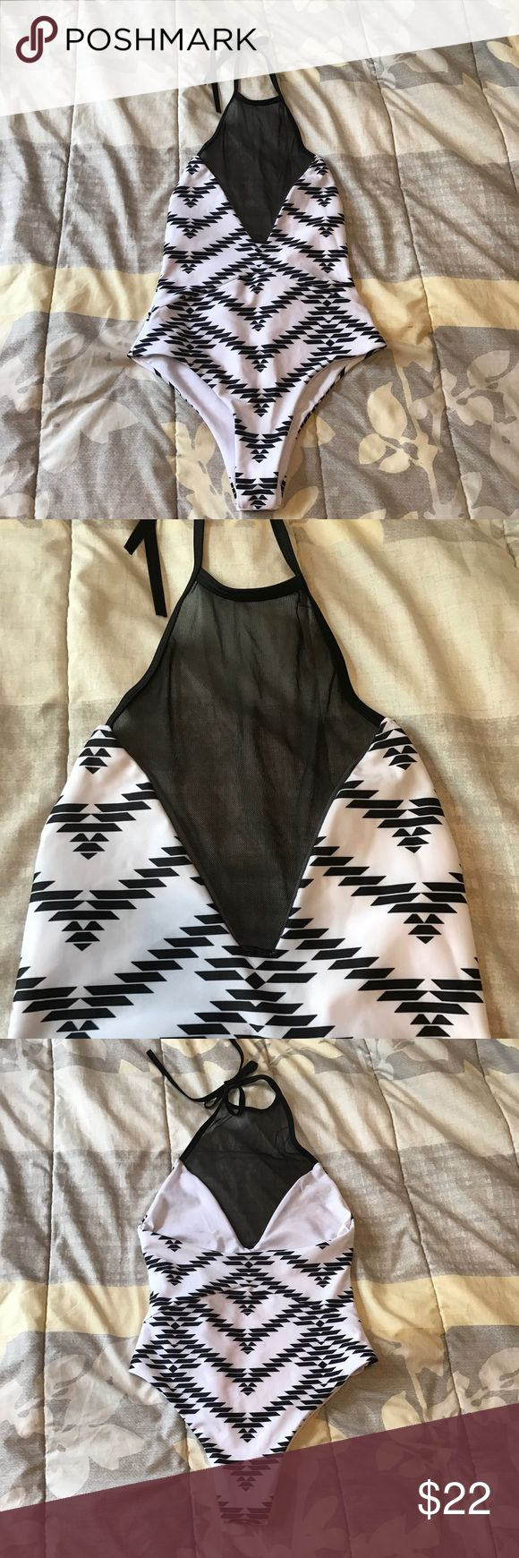 Sexy black and white one piece swimsuit NWOT, still has original hygiene liner. Tag says size L but fits more like a M Swim One Pieces