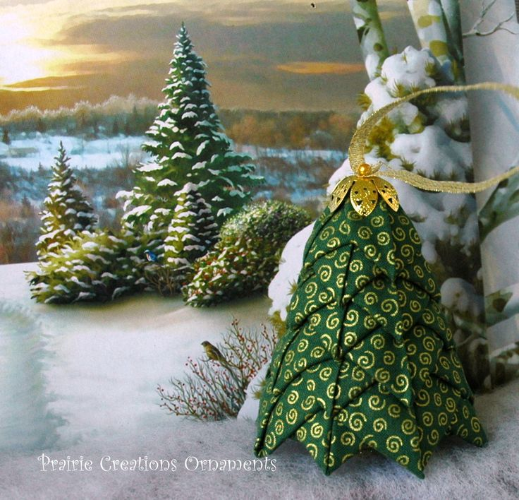 "This is a 3"" quilted fabric tree which can be used either as an ornament on the tree or will stand on its own to add to decor.  Kit comes with everything needed to complete this tree except for the straight pins.  You will need approximately 150 straight pins. This is an original Prairie Creations Ornaments design and pattern."