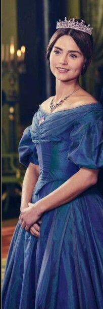 Jenna Coleman as Queen Victoria in blue gown.