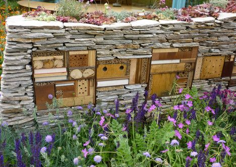 I can't say how wonderful I think these bug hotels are!  And unlimited design!  Beneficial insect habitat built into a stacked stone fence. Too cool!