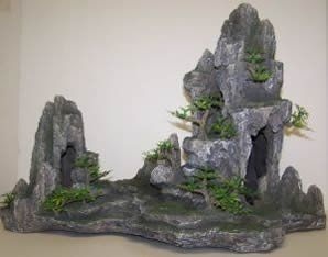 $34.29-$92.64 Add realism to your tank. Mountain is resin, the trees plastic. This piece adds interest and eye catching while providing an excellent hiding and swimming places for your fish. Offers the natural environment feeling.  Size 17.7 x 8.7 11.2in.