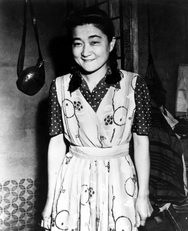 Iva Ikuko Toguri D'Aquino. An American who was on the wrong side of the border when Pearl Harbor was bombed.   Despite being trapped in Japan - she refused to renounce her U.S. citizenship.  In order to get rations she agreed to work for an English language radio station - where she became one of the many Tokyo Rose's.  When the Americans invaded Japan she was wrongly convicted of treason in 1949 and wasn't pardoned until 1977.  Tragic.
