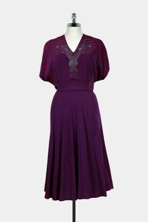 1930s style dress with beaded neckline and ample sass.
