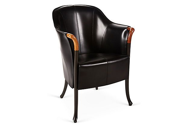 Progetti Blossom Leather Armchair, Black on OneKingsLane.com Art Nouveau-style curves, from the slender legs to the flared, exposed wood arms and leather seat, give this armchair a moody elegance. The armrests feature polished pau ferro.