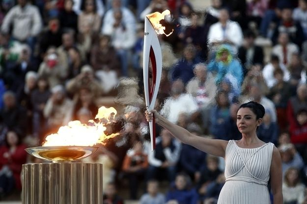 Russia's Olympic flame! It's been all sorts of crazy places, starting with this handover ceremony in Athens.