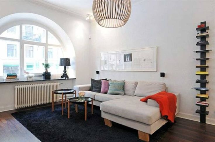 Interior:Endearing Scandinavian Interior Design Living Room With Gray Sofa And Cushions Table Also Bookshelf And Coffee Table Lamps Feat Black Fur Rugs And Laminate Wood Flooring For Scandinavian Living Room Design Living Room? Think about the Scandinavian Interior Design Living Room