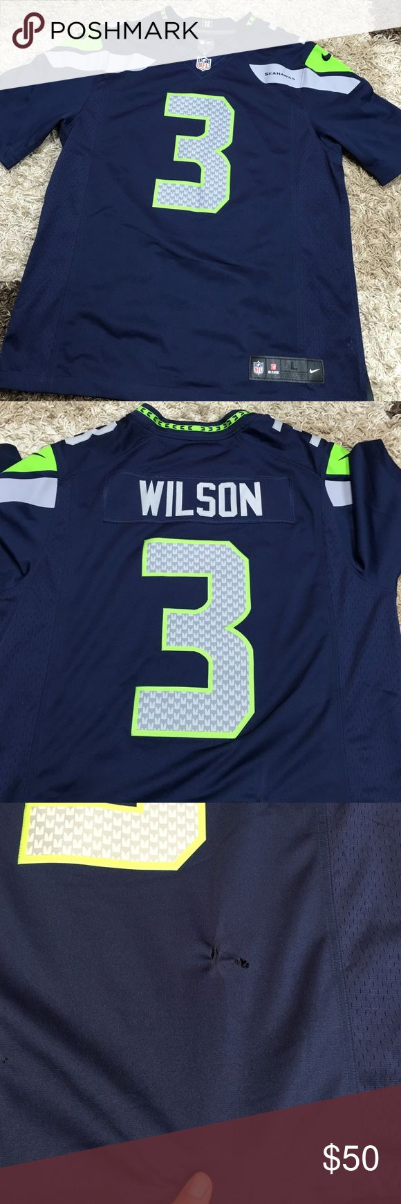 NFL Seahawks Wilson jersey The jersey has two spots with two small holes on the bottom back NFL Other