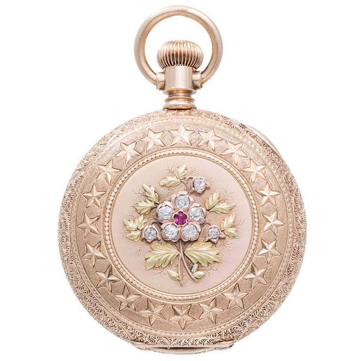 Agassiz Rose, Yellow and Green Gold Pocket Watch with Diamond and Ruby Accents | 14k rose, yellow and green gold pocket watch, circa 1890s. Intricate detail work to the front and back covers with fine old-cut gem stones. Federal-style stars on cover. Enamel dial. Set with diamonds and a ruby.