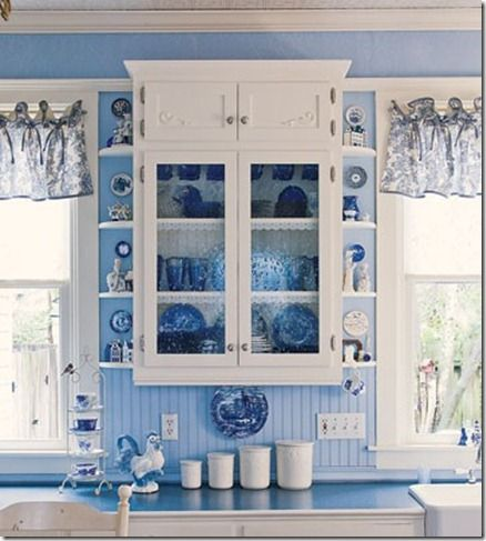 i love blue & white. blue cottage kitchen; blue beadboard and white cabinets. Needs a couple of corbels. Canisters!