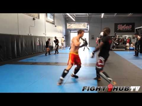 Uriah Hall knocks down sparring partner with a spinning back kick