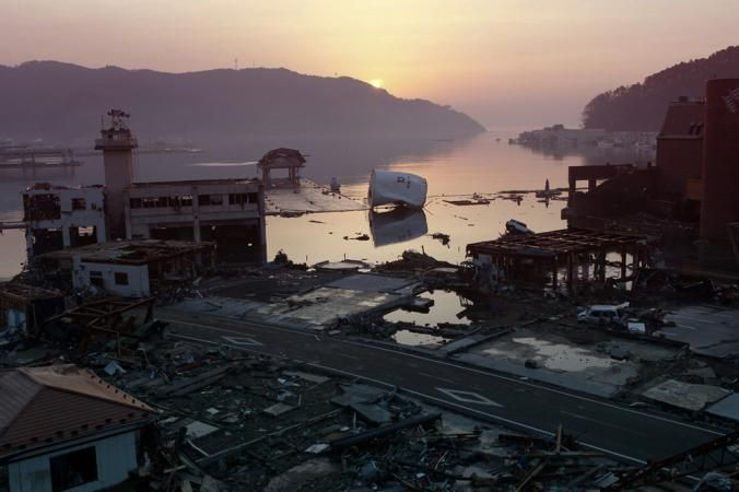 Japan earthquake shortened days, increased Earth's wobble.  The sun rises over debris in Onagawa, Japan, following a devastating earthquake.