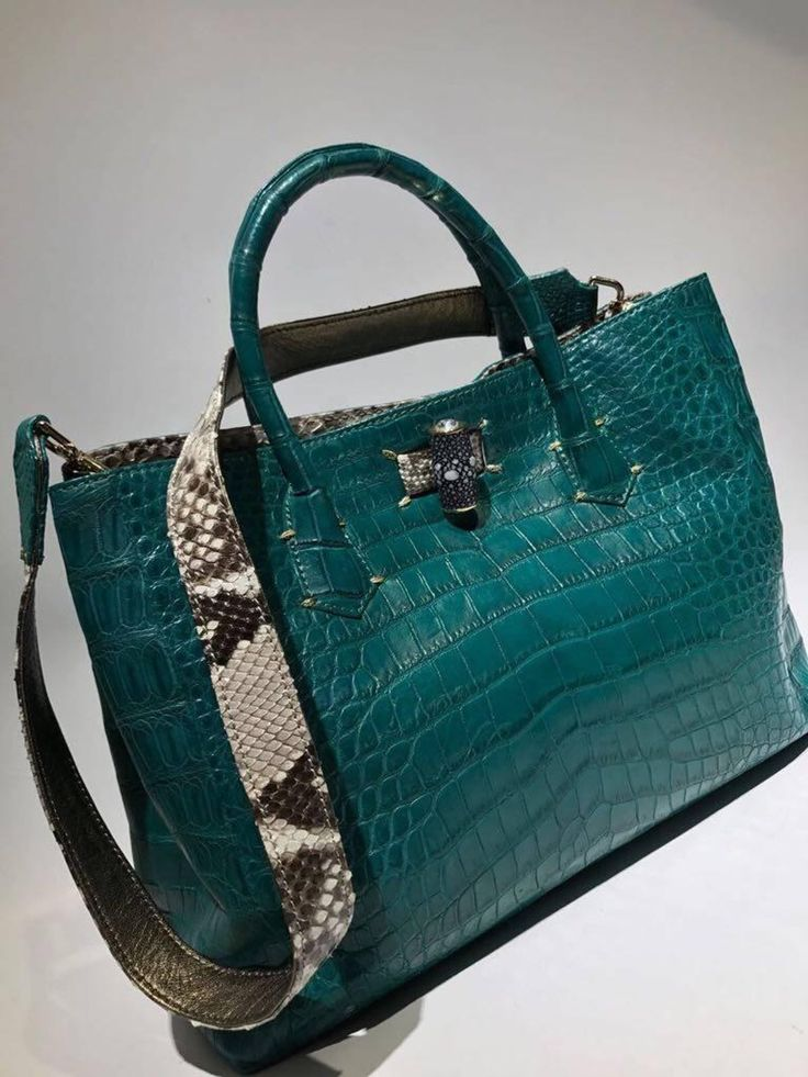 Ana Switzerland Crocodile Handbag | From a collection of rare vintage top handle bags at https://www.1stdibs.com/fashion/handbags-purses-bags/top-handle-bags/