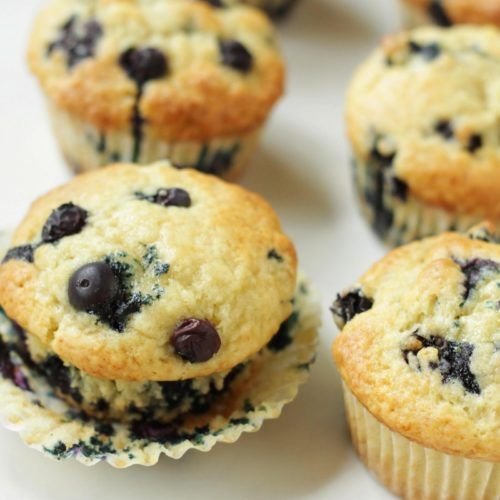 Lemon Zucchini Muffins Living On Cookies In 2020 Sour Cream Muffins Sour Cream Blueberry Muffins Frozen Blueberry Recipes