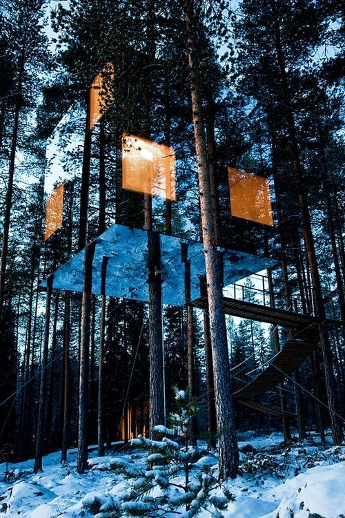 tree hotel in north sweden. mirrored to blend in with the forest. would be the most serene hotel to visit!