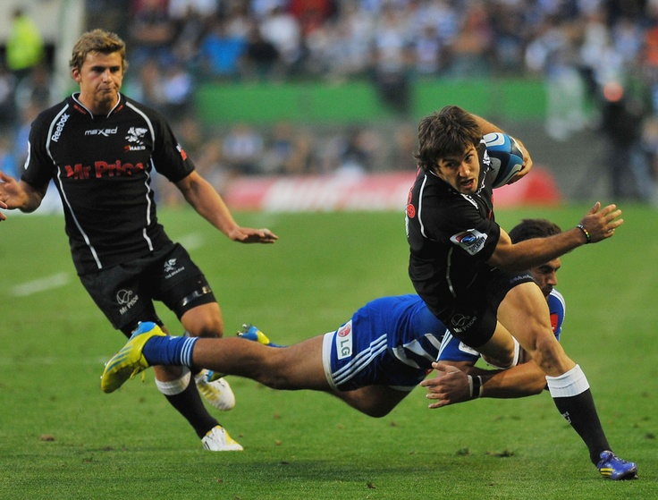 Paul Jordaan of The Sharks tries to get pass Damian de Allende of the Stormers during the Super Rugby match between DHL Stormers and The Sharks at DHL Newlands on April 13, 2013 in Cape Town, South Africa. #Super #Rugby #Stormers #Sharks