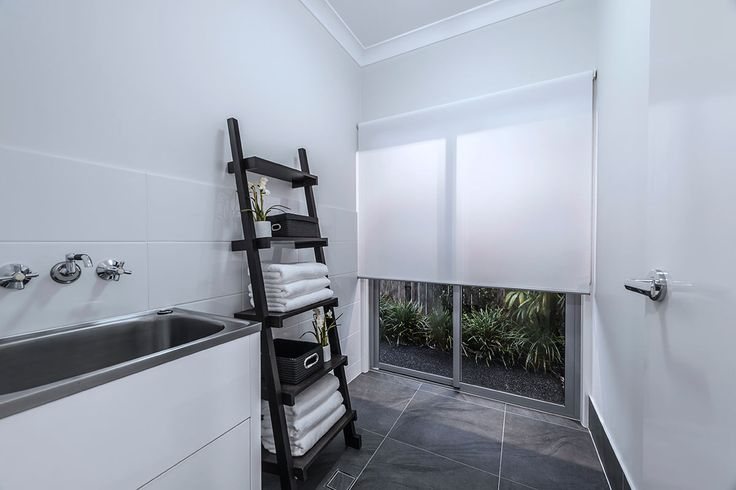 #Laundry #interior #design #ideas from #Ausbuild's Allendale display #home. The crisp white #walls and earthy #wooden #towel #rack create an airy feel and are great ways to make the most any available #space.