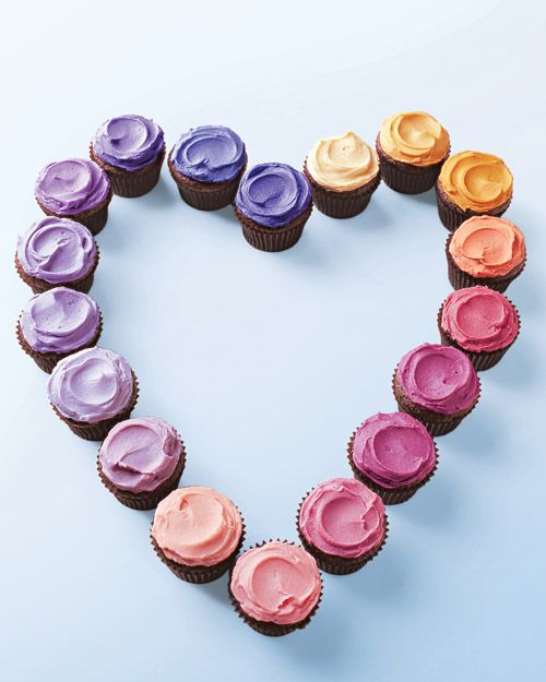 Arrange mini chocolate cupcakes topped with an array of bright colored frosting in a heart for a Valentine's Day party.