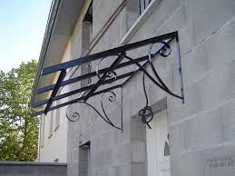 NEED authentically french door canopies and awnings. Les auvents de porte sur maisons anciennes.