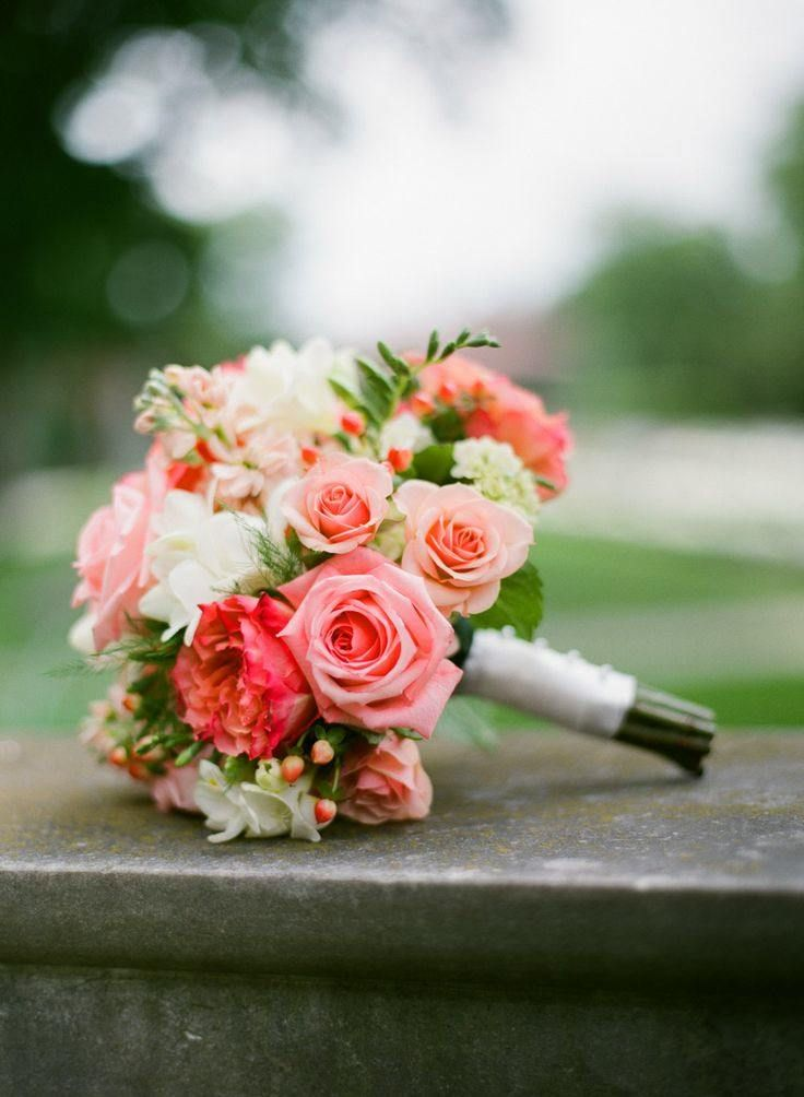 Full of romance, this bridal bouquet has the best mix of blooms in romantic coral, blush, and white.