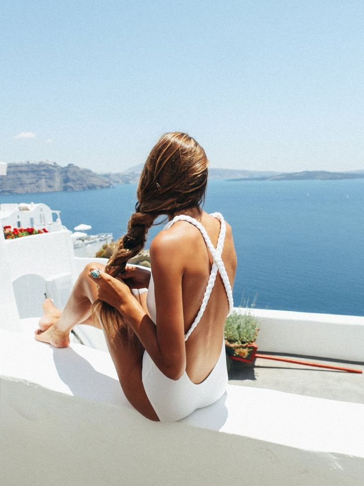 simple white one piece with criss-cross straps