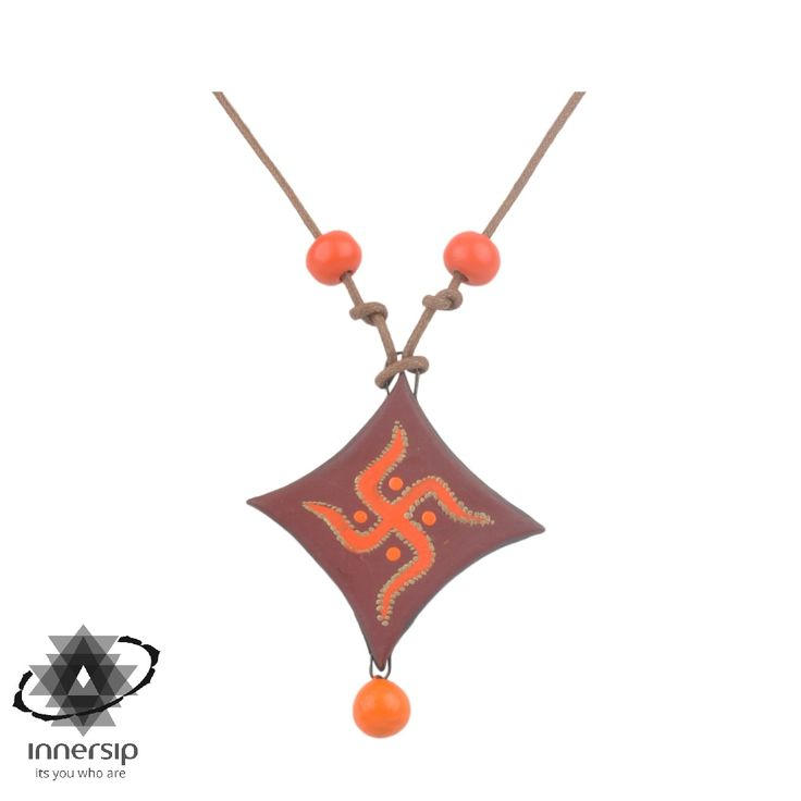 Spiritual in inspiration, symbolic in style—this handmade Swastika Pendant is created in terracotta to seek meaning in the style. #innersip #yoga #hinduism #dharma