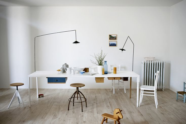Treverkhome is a colored body porcelain stoneware where the natural aspect and feeling of wood come together in a never seen before manner. Perfect for a white dining room.