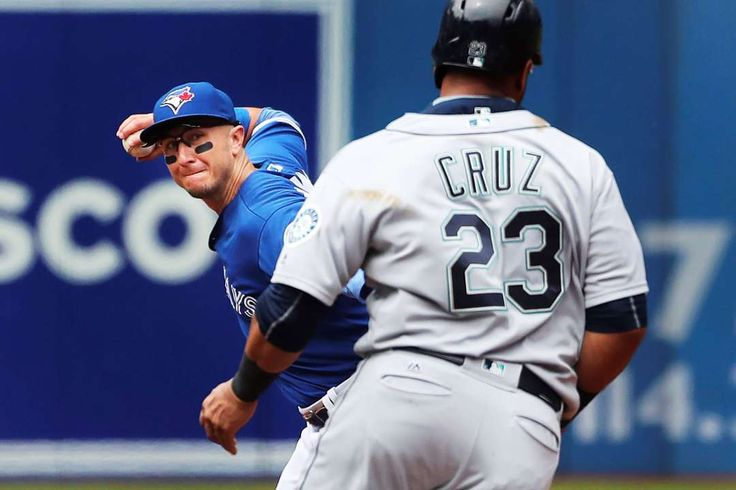 Cruz out on a double play: Blue Jays shortstop Troy Tulowitzki throws to first base after getting Mariners designated hitter Nelson Cruz out at second in the second inning on July 24 in Toronto.
