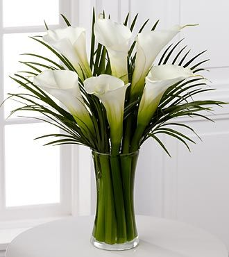 Calla Lilies with palm leaves.