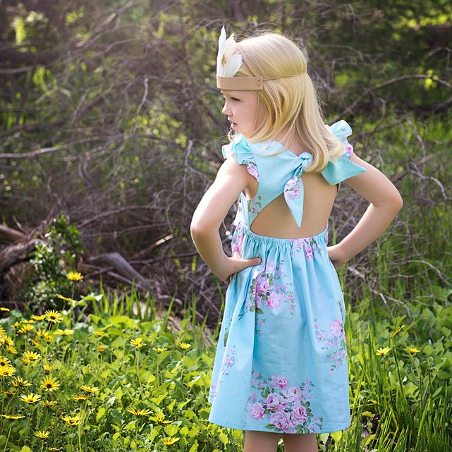 This beautiful vintage inspired dress is everything a girl could ask for: sweet, breezy and topped with a bow. Our Free Spirit dress in this shabby chic floral features some unique design quirk...