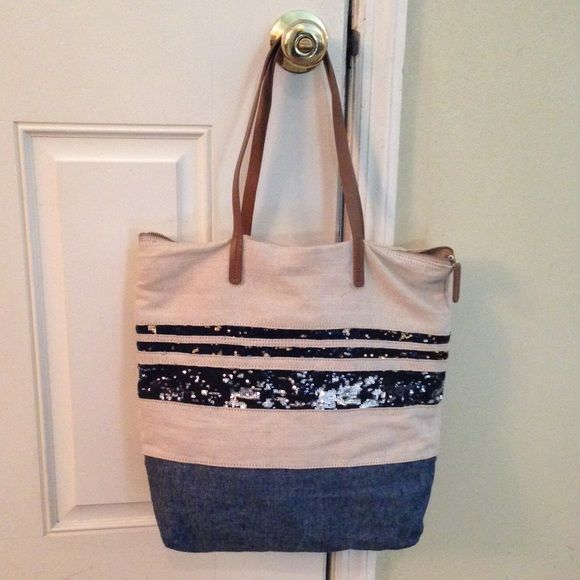 """Gap Tote Bag Cool Gap sequin striped tote bag. Fully lined. Zip top closure. Interior zipper pocket and cell phone slot. Lightweight woven canvas fabric. Leather straps.  Color: Tan and Blue Material: Woven Canvas  Dimensions:  13"""" x 15"""" x 4.5"""" Condition: GUC GAP Bags"""
