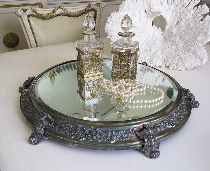 antique plateau mirror, a beautiful way to display lovely parfume bottles.