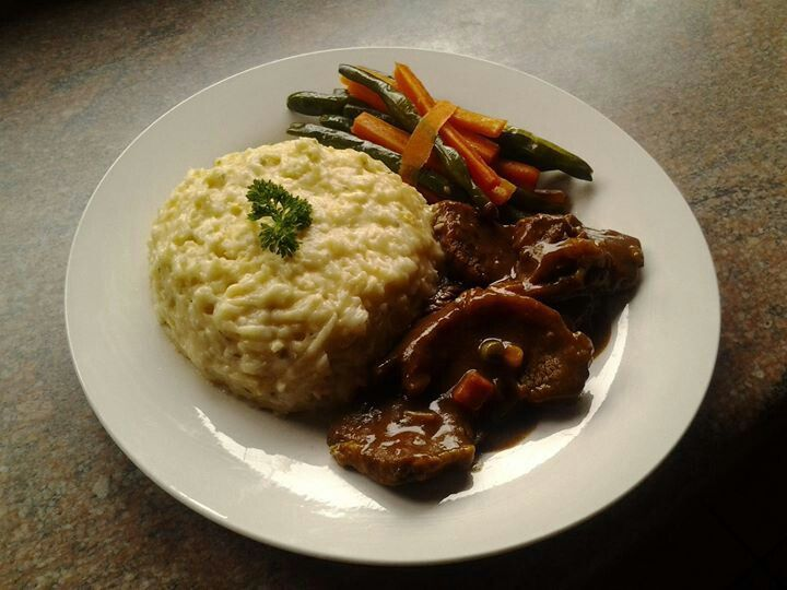 I love good food.  This is white samp with cheese sauce and herbs, beef curry and green beans and carrots.