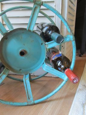 Couldn't help but post this wine rack idea. Old hose reel turned
