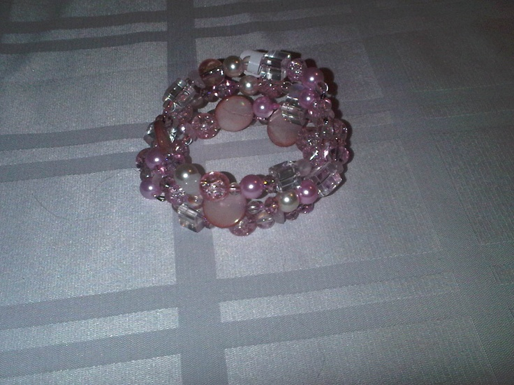 This memory wire bracelet has various shades of pink beads in different sizes and shapes